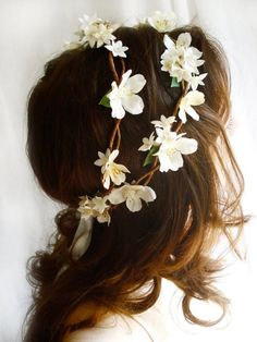I want my hair to have some jewels or flowers in it for my wedding. Just not big flowers like this one or huge fake diamonds or something like that. I want it to be light and goddess-like. Very effortless if that makes sense.
