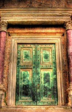 Rare purple marble and bronze doors adorn the entry to this old building near the Forum in Rome Italy. By Paul Koester.