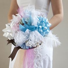 Check out this step by step tutorial for creating a bridal shower bow bouquet! It's tradition to use it during your wedding rehearsal!
