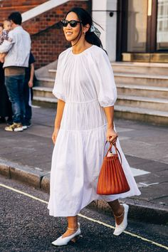 Maxi white dress with puffed sleeves white shoes and a tan statement bag for a chic Fall outfit Photo by Acielle/ Style du Monde White Maxi Dresses, Nice Dresses, White Dress, Sandro, Cool Street Fashion, Casual Street Style, Looks Style, London Fashion, Style Inspiration