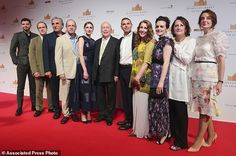 Ensemble: Downton Abbey's cast and producers posed at an exhibition about the television series in Singapore Wednesday, as NBC exec Michael Edelstein confirmed a film adaptation of the program is 'in the works'