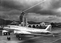Before the city of Los Angeles developed LAX, it's next best thing was the Glendale airport (aka Glendale Municipal Airport, then later Grand Central Air Terminal) on the valley side of the Hollywood hills. This photo shows a Douglas DC-3 shining in the darkening night some time during the late 1930's - 40s.