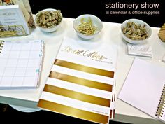 UPDATE- Teresa Collins stationery show... calendar, brochure, gold office supplies (book labels, paper clips and gold binder clips, and gold foiled notebook.