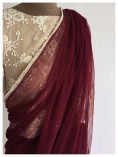 Deep maroon with nude blouse for a evening party Latest Elegant Designer Saree Click Visit link above to see Blouse Designs High Neck, Best Blouse Designs, Saree Blouse Designs, Blouse Patterns, Indian Dresses, Indian Outfits, Indian Clothes, Maroon Saree, Modern Saree