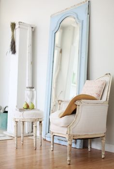 Love the powder blue color mirror frame! The whole space looks very pretty :)