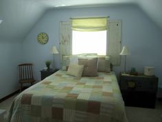 my sister's master bedroom. love the shutters on the window and the simple DIY roman shade.