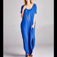 BOUTIQUE maxi dress Royal blue maxi dress. Features side pockets, u shaped hem, v neck, short sleeves and an over all loose fit. New with tags. 96% rayon 4% spandex Boutique Dresses Maxi