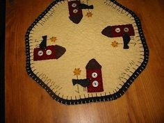"Offered to you by: Bit of Cloth This is a new primitive candle mat. I have handcrafted this from woolfelt and hand-sewn all the pieces with great care. The candle mat is 9"" in dia. This is a design th"