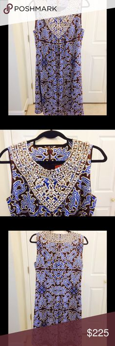 Gorgeous TORY BURCH Silk Dress with Beads Gorgeous Tory Burch Silk Dress with Beaded Front & Collar Beautiful brown and blue pattern  Very flattering scoop neck adorned with beads all around and front  Size: 12  Very Good condition - no rips or tear or odor - only worn once Knee-Length 100% Silk Fully Lined From a smoke-free and pet-free environment Tory Burch Dresses