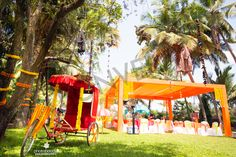 Bright colours, Small elements, fun a photo booth and lots of nature turns magical like this.  #Mehandi #BrightColourSetUp #Rikshaw #OldButCrazy #Trees #WedMeGood #IndianWeddings  http://bonvera.in