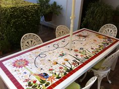 Rectangular outdoor mosaic table with floral design. Mosaic Garden Art, Mosaic Art, Mosaic Glass, Mosaic Tiles, Stained Glass, Glass Art, Mosaics, Tiling, Mosaic Patio Table