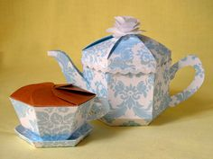 OK, so it was inevitable that this was going to happen ... Recently, I created this lovely flowery teapot box, and with the left...