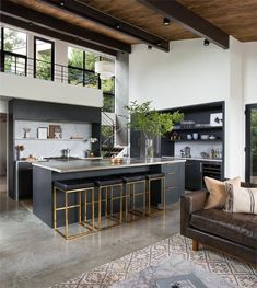 The entry segues into the open kitchen and living space. The second-floor mezzanine was once enclosed. By removing its walls, the architects brought in more light and a better connection to the outdoors. Modern Kitchen Design, Interior Design Kitchen, Modern Design, Stone Interior, Black Kitchens, Cool Kitchens, Beautiful Kitchens, Remodeled Kitchens, Renovated Kitchen