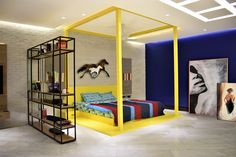 The eclecticism and surreal nature of the teenage boy is captured with the bold and playful colors of yellow and dark blue. This young vibrant room was left with minimal furniture for providing space for other activities and small hangouts with friends by A.J Architects. Dyi, Tv Unit Furniture, Décor Boho, Wave Pattern, Bunk Beds, Halloween, Decoration, Facade, Simple