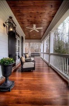 Hello, beautiful porch! This is the outdoor area I want to have in my life. Gorgeous wooden floors, comfortable chairs, & a lovely view. What could be better?