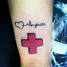 "My new tattoo. As a registered nurse I wear my red cross with pride. And ""love, life, faith"" bc I love what I do, I help save lives, and it takes a lot of faith to be a nurse :)"