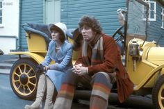 Sarah Jane Smith (Lis Sladen) and the Doctor (Tom Baker) sitting on Bessie's running board.