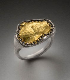 Todd Pownell: Gold Top, Palladium ring with 18k hammered yellow gold top with inverted bead set black diamonds.