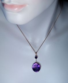 Moscow, 1950s / early 1960s A 14K rose gold necklace features asparklingoval Russian amethyst of a medium purple color. The amethyst measures 17.8 x 15.8
