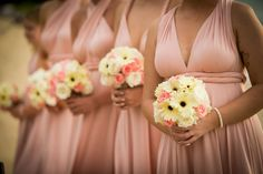 Stunning soft pink dresses (Dessy) with cream and pink bouquets - cream gerberas and roses and soft pink roses. #farawayweddings #weddingsinthailand #beachwedding