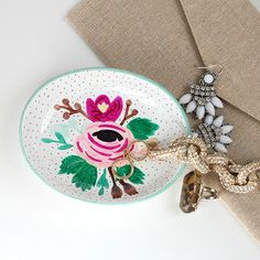 Embellish a dainty, decorative dish by displaying it with your favorite jewelry.