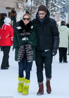 Protective: Johannes held onto new spouse Olivia as the two went for a stroll in snowy Gstaad