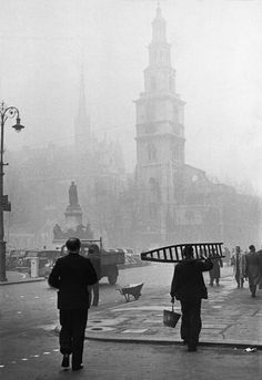 Henri Cartier-Bresson - London. 1951. In the background, the Gladstone monument, the church of St Clement Danes and the spires of the Royal Courts of Justice
