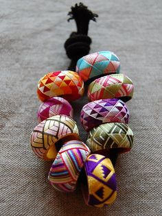 Yubiniki...Japanese embroidered thimbles...similar methods as Temari...the patterns seem to be used as the Obi, or center, of the Temari