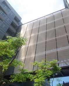 HAVER Architectural Mesh cladding at Cheng Kung University. The mesh panels are tensioned over the full height of the facade.