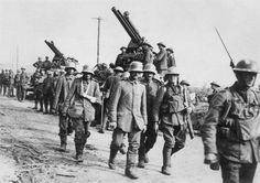German prisoners of war marching past a British antiaircraft battery as they are escorted by British soldiers Western Front World War I