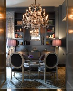 3  This room gives a dark feeling. The dark walls and chairs are very heavy feeling the chandelier and lamps add to the feeling.