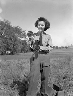 Sergeant Karen M. Hermiston of the Canadian Womens Army Corps, holding a Rolleiflex camera.