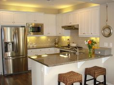 Traditional Kitchen with Breakfast bar, Hardwood floors, Limestone Tile, High ceiling, U-shaped, Raised panel, Flush