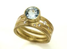 Triple Wave Band in Gold with Center Aquamarine and Diamonds