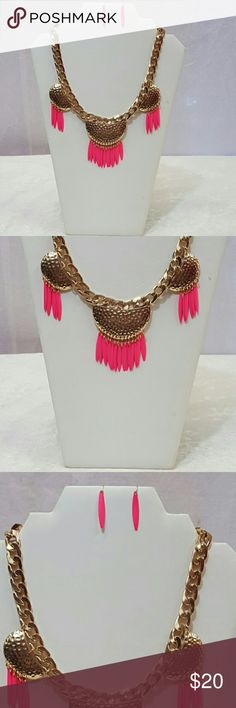Beautiful fuschia and gold statement necklace set Beautiful fuschia and gold statement necklace and earring set.  Makes a great gift wear any season....winter, spring,  summer, fall. Jewelry Necklaces