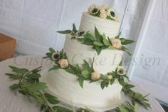 Wedding cake decorated with rustic lines, flowers and foliage  Perfect for any Rustic Theme Wedding!