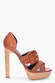 RUPERT SANDERSON //   Brown Merle Heels  21364F129009  Textured leather platform heels in brown. Open toe. Dark brown zigzag feature stitching at toe, shoe face and heel. Oversize adjustable buckle strap at shoe face. Tone on tone stitching. Approx. 1.5'' platform, 5'' heel. Upper: 100% leather. Sole: 90% leather, 10% rubber. Made in Italy.  $860.00 CAD  $258.00 CADYou Save 70%