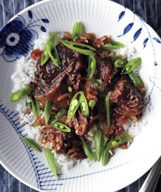 Short ribs simmer in a mixture of onion, garlic, vinegar, soy sauce, ginger, and crushed red pepper until juicy and tender. Get the recipe for Soy-Braised Short Ribs With Sugar Snap Peas.