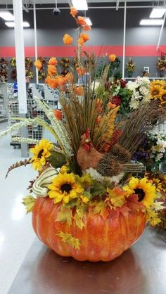 Pumpkin arrangement with rooster at Michael's in Longview Washington