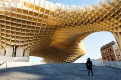 Metropol Parasol is a wooden structure located at La Encarnación square, in the old quarter of Seville, Spain.Parasol contains a market, shops,& a podium for concerts and events.In the basement is an Antiquarium,where Roman & Moorish remains discovered on-site are displayed in a museum.On the roof there is an open-air public plaza,shaded by the wooden parasols above & designed for public events. There are panoramic terraces,including a restaurant, & some of the best views of the city centre.
