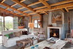 farmhouse-beautifully-transformed-into-a-rustic-home-2  Love the salvaged tin walls and ceiling.