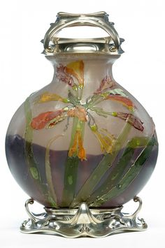 """Vase """" Africana """" Emile Gallé (1846-1904) Nancy, 1900 Mount Edmond Cardeilhac after Lucien Bonvallet (1861-1919), 1901 Blown glass and glass inlay, engraved, silver mount"""