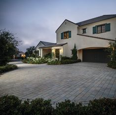 See Belgard's collection of concrete and brick pavers. Explore elegant stone patio pavers, concrete driveway pavers, paver walkways, and hardscape paving stones. Concrete Driveway Pavers, Stone Driveway, Driveway Design, Paver Walkway, Brick Pavers, Home Design, Paving Ideas, Outside Living, Backyard