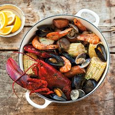 Leave the sand at the beach and serve this brimming pot for a fun, casual gathering. Diners can pick out hunks of corn, potatoes, sausages, a clam here and a lobster claw there. Just provide plenty...