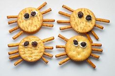 These Halloween spider crackers are an easy recipe that kids can make themselves for a somewhat healthy snack..