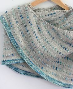 Ravelry: Dot Shawl pattern by Casapinka - The pops of color & texture here are great. And I am a big fan of not being bobbles. #knitindie