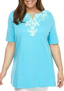 6e9e11b8fa79 A kurta print lines the neckline of this short sleeve tunic by Kim Rogers®,