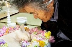 Japan's most famous grandmother kissing her companion of ten years goodbye