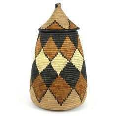 Traditionally woven to store beer, these baskets are handwoven in South Africa and often given as wedding gifts. This basket has a tight-fitting lid and is adorned with traditional Zulu designs in natural dyes. Basket measures 20 inches tall by Basket Weaving, Hand Weaving, Zulu Wedding, Kwazulu Natal, Some Text, Single Piece, Furniture Decor, Wedding Gifts, Artisan