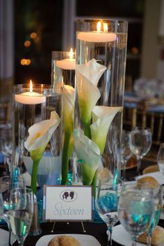 Submerged lilies is my first and favorite option for my centerpieces! Instead of the marbles, I would add sea glass to get both the aqua, cobalt blues and green colors... plus, sea glass is perfect for an ocean themed wedding!